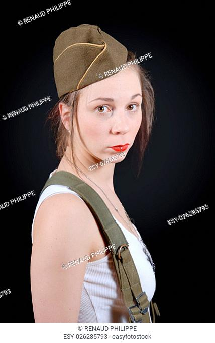 a sexy young woman posing in WW2 military uniform