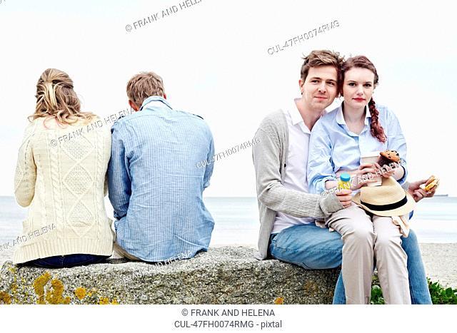 Couples having breakfast outdoors