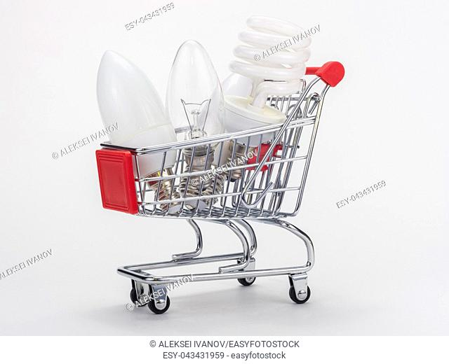 In the grocery cart are three light bulbs: incandescent, energy-saving and LED