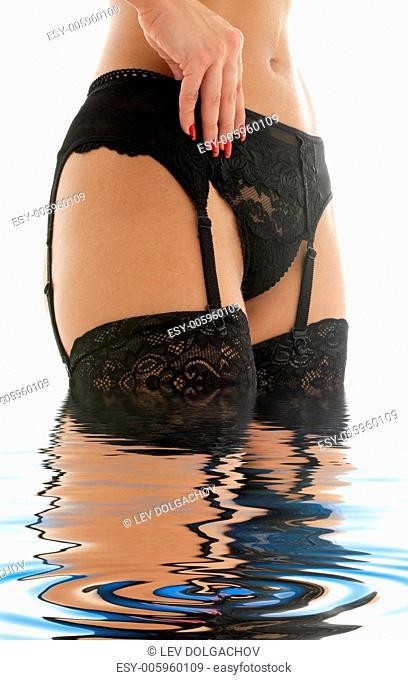 black stockings and garter belt torso in water