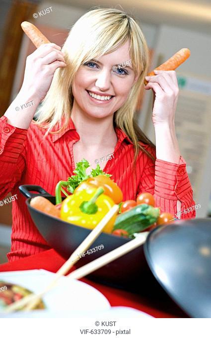 junge Frau in Kueche - Nieder÷sterreich, Ísterreich, 14/02/2008