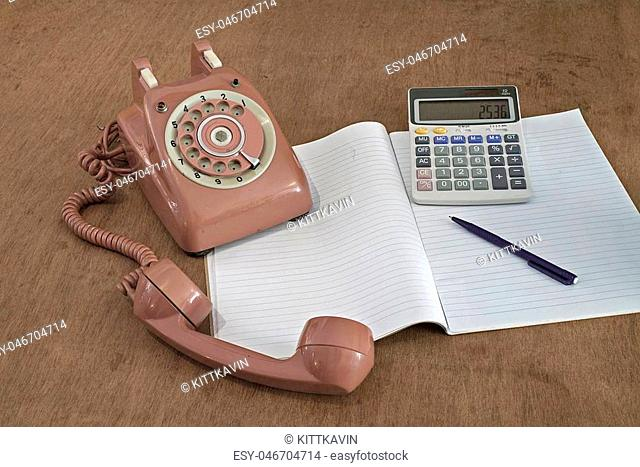 Retro brown telephone on wood table