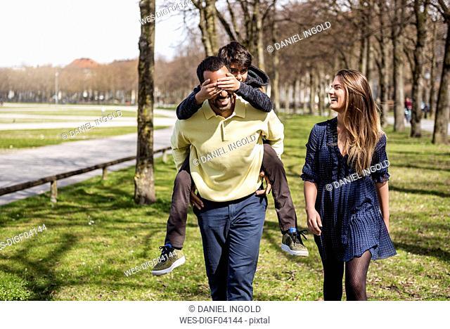 Happy family walking in a park