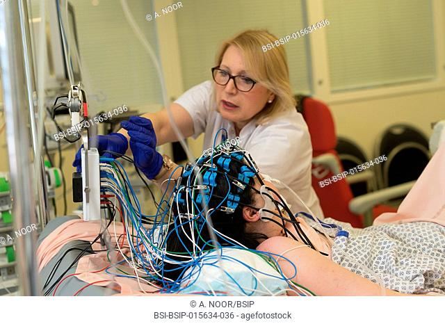 Reportage in the epileptology unit in Nice Hospital, France. Carrying out an emergency EEG in the intensive care service on a patient who was hospitalized...