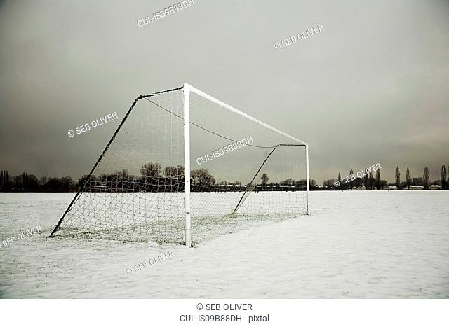 Soccer goalpost on snow covered soccer pitch