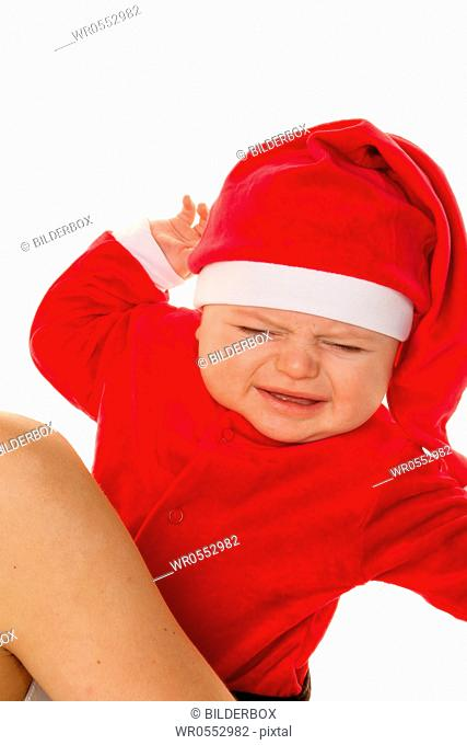 Little baby dressed as Santa Claus.Infant as Santa Claus