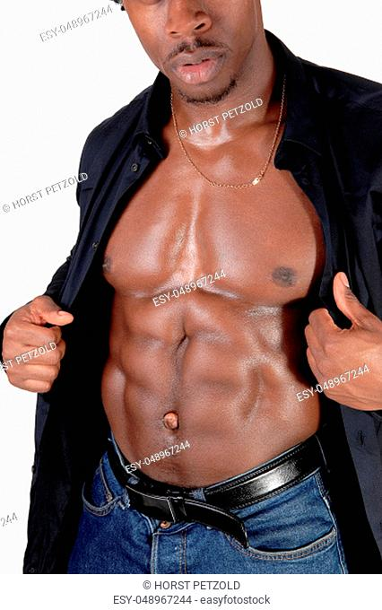The chest and abdomen of an African American man standing with his.black shirt open, showing his great figure, isolated for white background