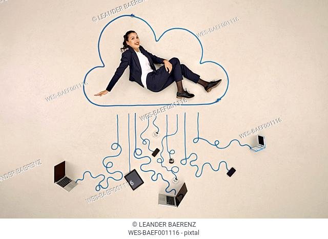 Businesswoman sitting in a cloud connected to mobile devices