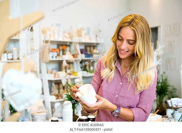 Woman shopping in small boutique