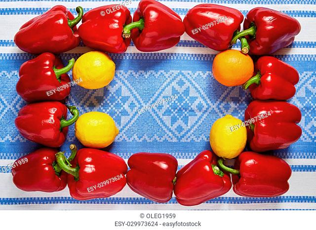 Festive frame from ripe vegetables and fruit on a blue towel