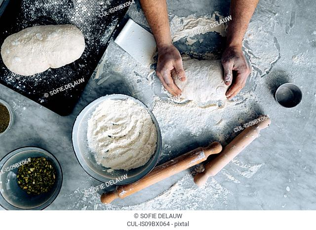 Chef kneading pastry dough