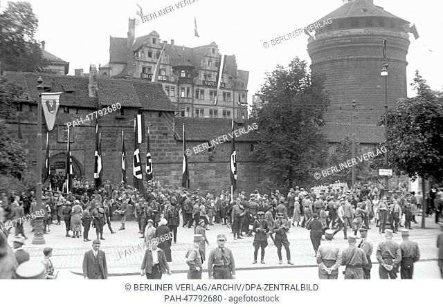 Nuremberg Rally 1933 in Nuremberg, Germany - Members of the SA (Sturmabteilung) in front of the medieval city wall and its tower Frauentorturm in Nuremberg