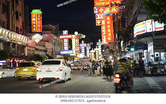 View down Thanon Yaowarat road at night in central Chinatown district of Bangkok Thailand. Yaowarat and Phahurat is Bangkok's multicultural district