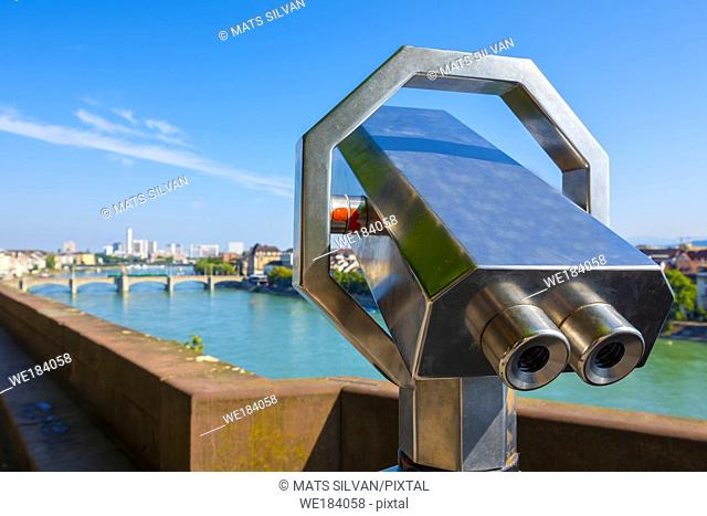 Telescope over Rhine River and City of Basel in a Sunny Day in Switzerland
