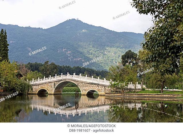 Bridge over lake, Yunnan ethnic village, Kunming Ethnic Minorities Village, Kunming, Dongchuan District, Yunnan province, China