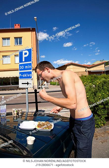 Eating kebab from the hood of the car Ljusdal, Sweden