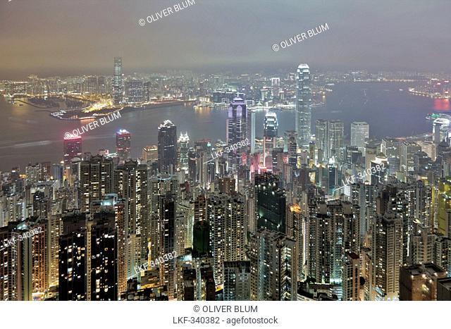 View of Hong Kong from Victoria Peak towards Victoria Harbour and the illuminated skyscrapers at night, Hong Kong, China