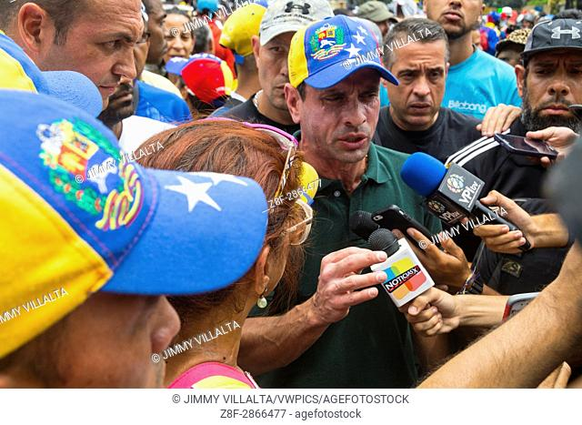 State Governor Miranda, Henrique Capriles Radonski, makes statements to the press on the march. MUD (Bureau of Unity) marches along with thousands of...