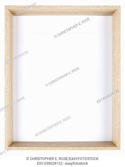 Empty picture frame isolated on white in a deeply recessed wood grain moulding with a mount