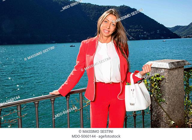 The senator Mariarosaria Rossi wearing a suit by Elisabetta Franchi and a bag by Maffei at the Forum Ambrosetti in Villa d'Este. Cernobbio, Italy