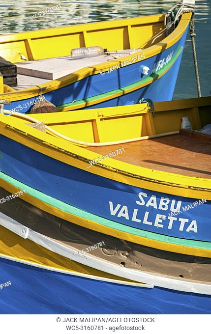 maltese traditional colorful painted luzzu boats in marsaxlokk fishing village malta