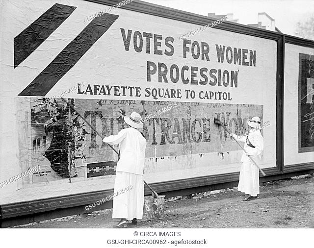 Two Women Putting Up Poster for Women's Suffrage Parade, Washington DC, USA, circa 1914