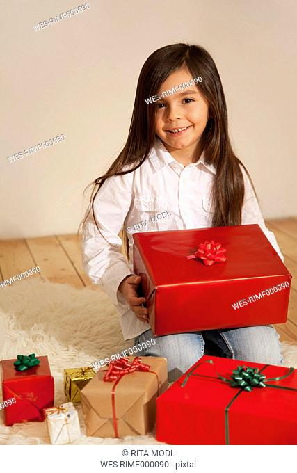 Girl with christmas present, smiling, portrait