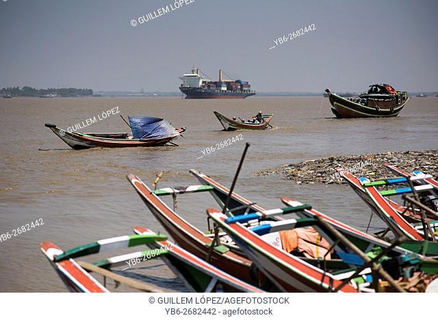 Long tail boats and ships at the Irrawaddy River in Dala, Yangon, Myanmar