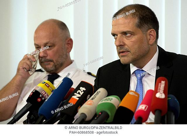 Kriminaloberrat Detlef Lenk (r) and police president Dieter Kroll hold a press conference in the police headquarters in Dresden, Germany, 18 August 2015