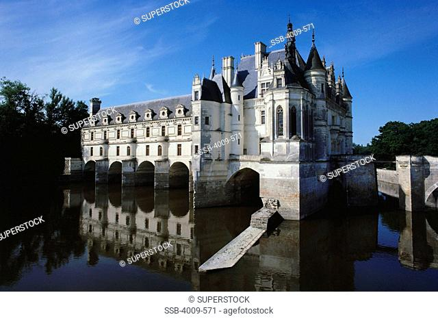 Reflection of a castle in water, Chateau De Chenonceau, River Cher, Chenonceaux, Loire Valley, France