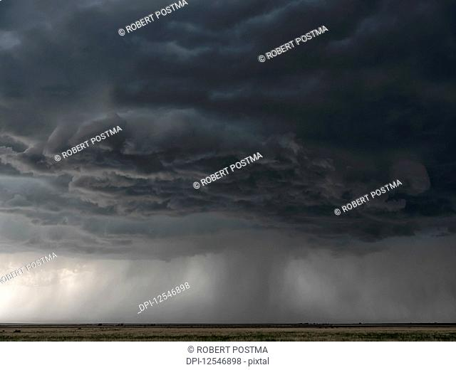 Dramatic skies over the landscape seen during a storm chasing tour in the midwest of the United States; Kansas, United States of America