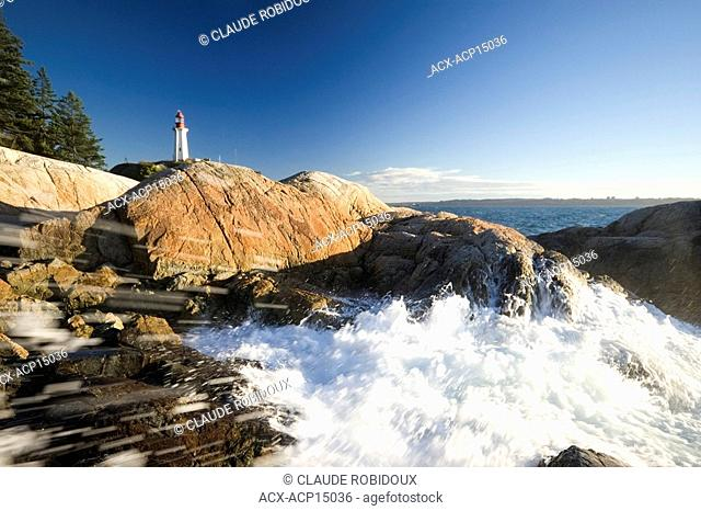 Waves splashing on rocks at Point atkinson lighthouse park in West Vancouver British Columbia Canada