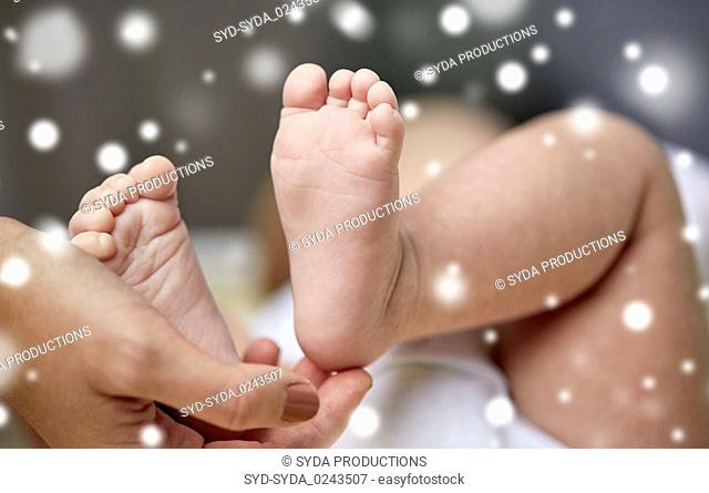 close up of newborn baby feet in mother hands