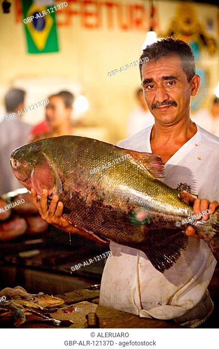 Man Holding Fish, Fair of the Fish, Barão de São Domingos Collapse, Amazônia, Manaus, Amazonas, Brazil
