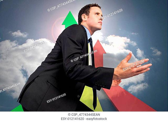 Composite image of businessman posi