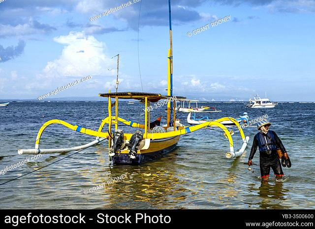 A Traditional Jukung Sailboat On Sanur Beach, Bali, Indonesia
