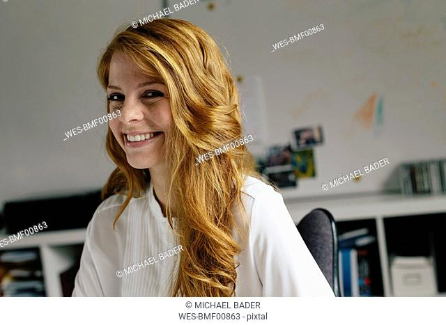 Portrait of smiling young woman in office