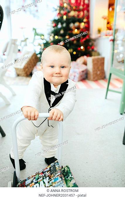Elegant baby boy looking at camera