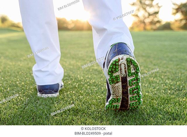 Grass sticking to shoe of golfer