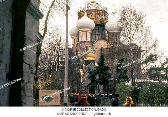 View of visitors outside the Cathedral of Our Lady of Smolensk, at the Novodevichy Convent located in Moscow, Soviet Russia, USSR, November, 1973