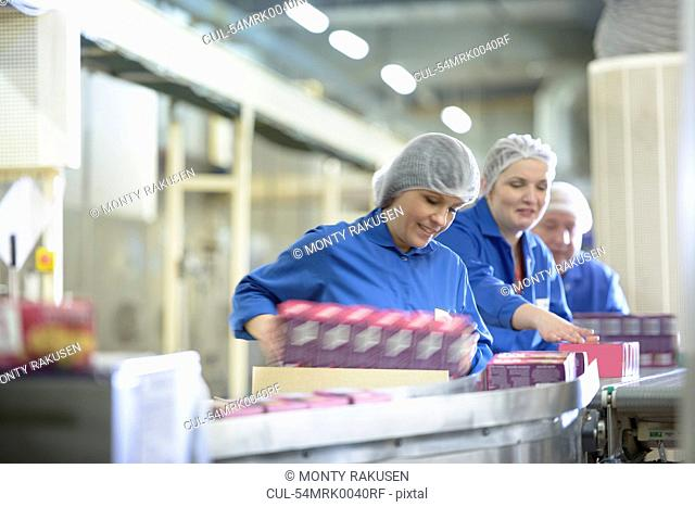 Workers packing in biscuit factory