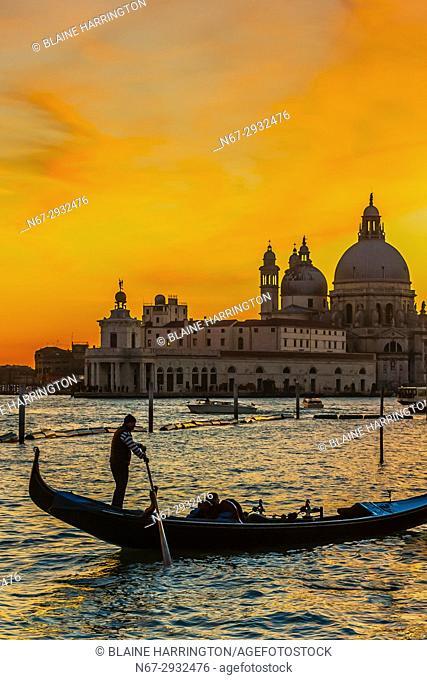 Gondolas cross the Venice Lagoon with Basilica di Santa Maria della Salute in background, Venice, Italy