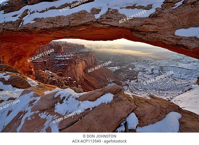 Mesa Arch in winter, with fog, Canyonlands National Park, Utah, USA