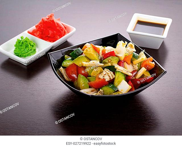 salad of tomatoes, cucumbers, asparagus, red pepper dressed with olive oil