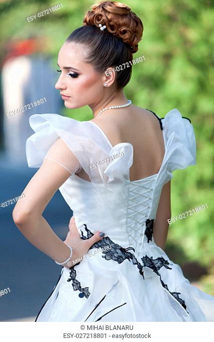 Lovely young woman wearing a white wedding dress