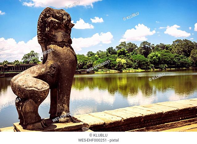 Cambodia, Siem Reap, Angkor Wat with sculpture in the foreground