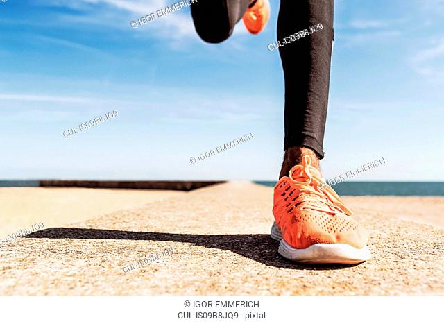 Man running outdoors, low section