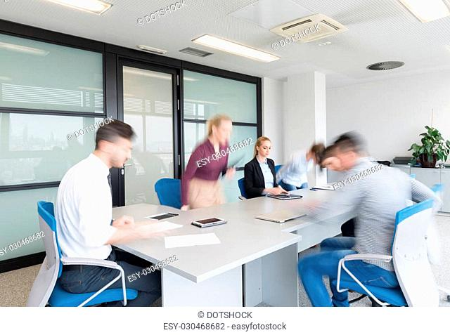 startup business, young creative people group entering meeting room, modern office interior and motion blur