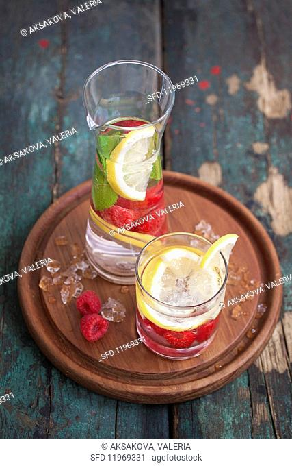 Refreshing water flavoured with raspberries, lemon and mint