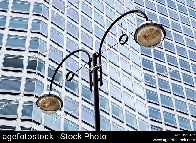 Street lighting with a background rower block in the centre of Birmingham, England UK